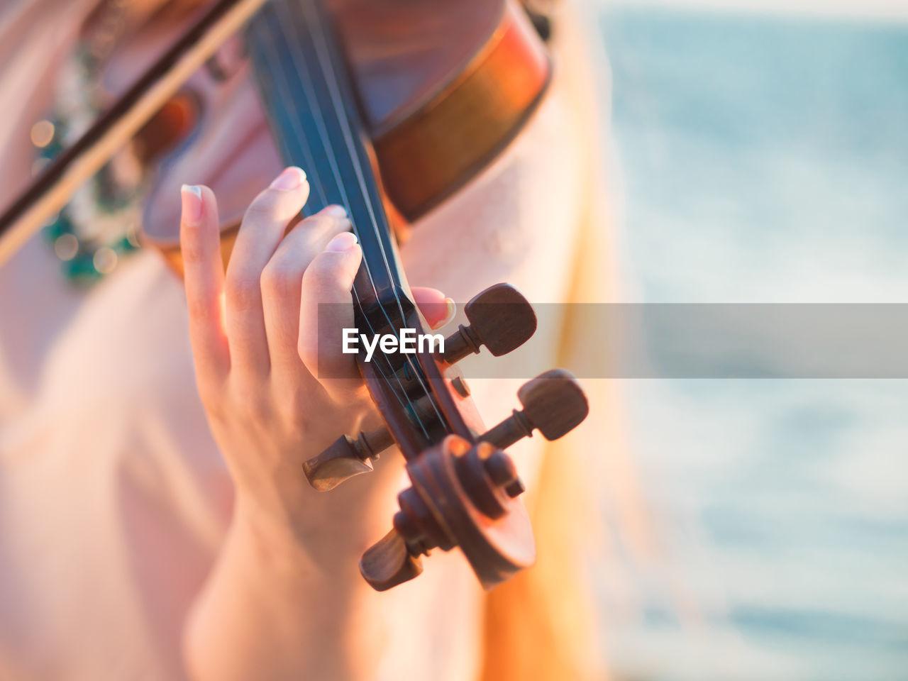 Close-Up Of Hand Playing Violin