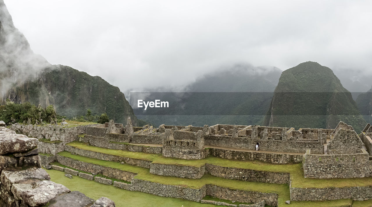 Rocky Mountains At Machu Picchu During Foggy Weather