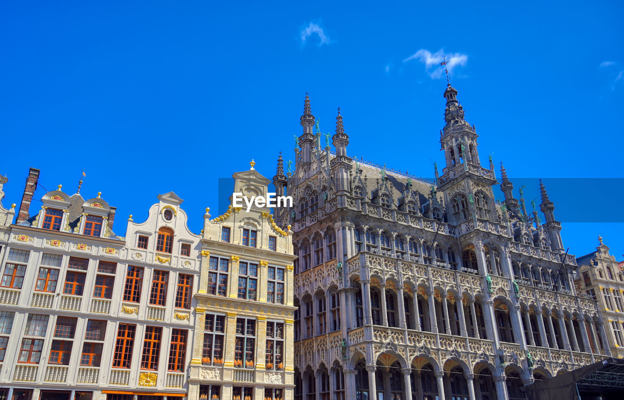 building exterior, architecture, built structure, sky, building, low angle view, travel destinations, history, blue, the past, city, nature, window, no people, tourism, travel, day, sunlight, facade, ornate, gothic style, government