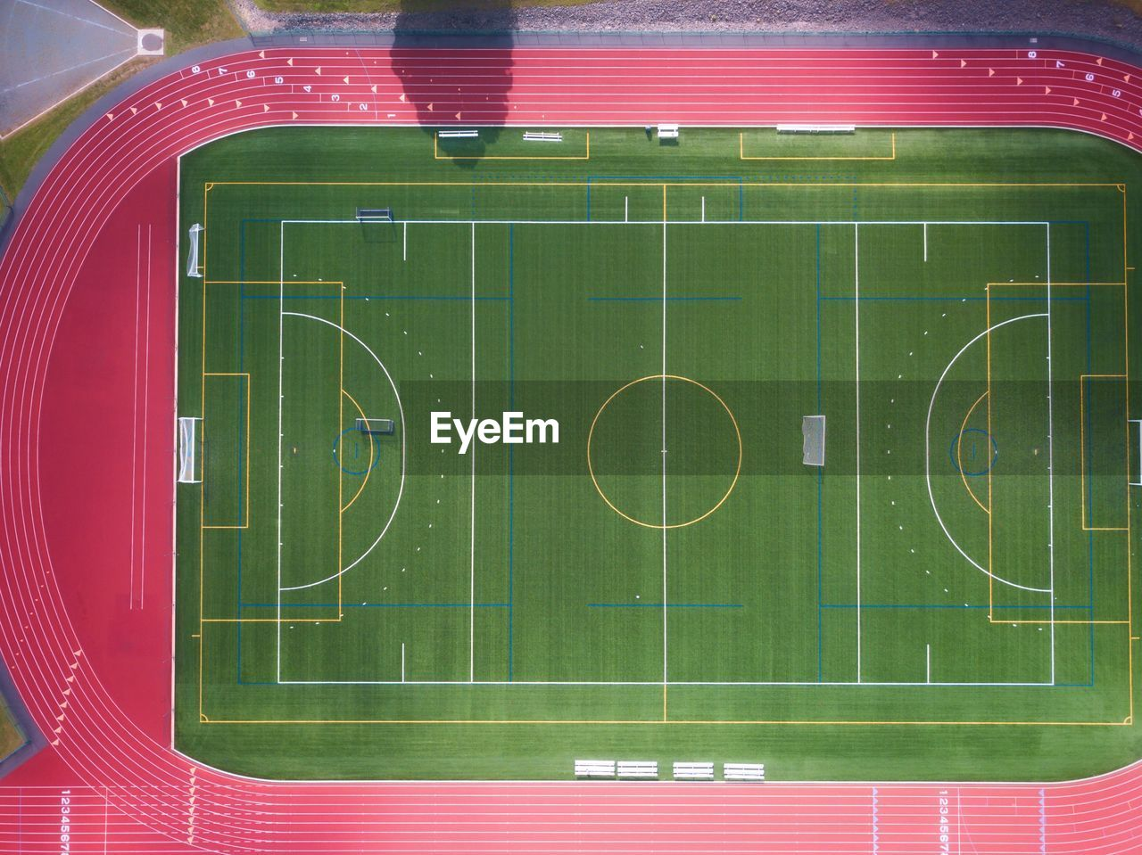 sport, green color, playing field, team sport, soccer, no people, competition, soccer field, high angle view, court, stadium, playing, american football field, outdoors, grass, sports equipment, number, blackboard, architecture