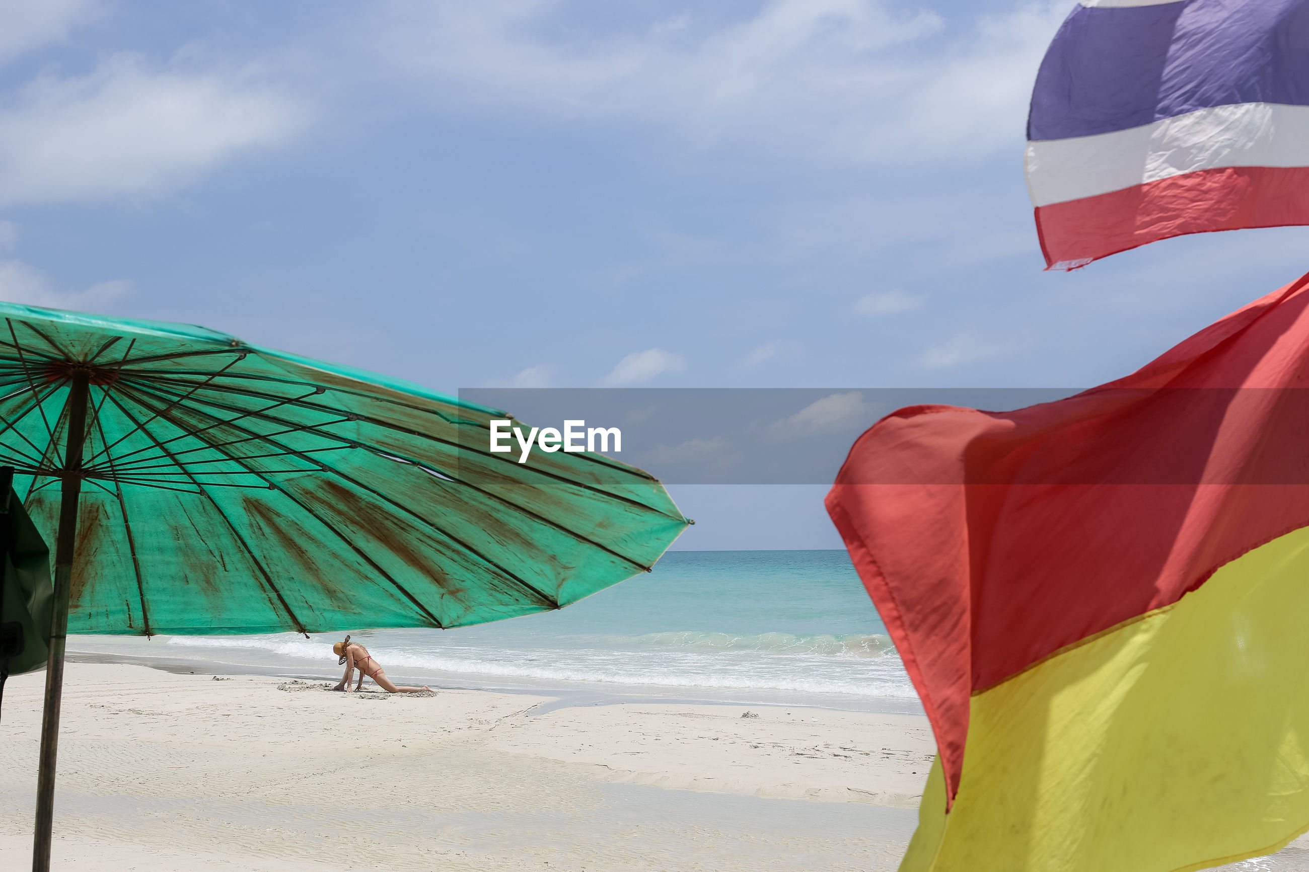 beach, flag, sea, sky, cloud - sky, sand, day, outdoors, nature, one person, beauty in nature, real people, water, people