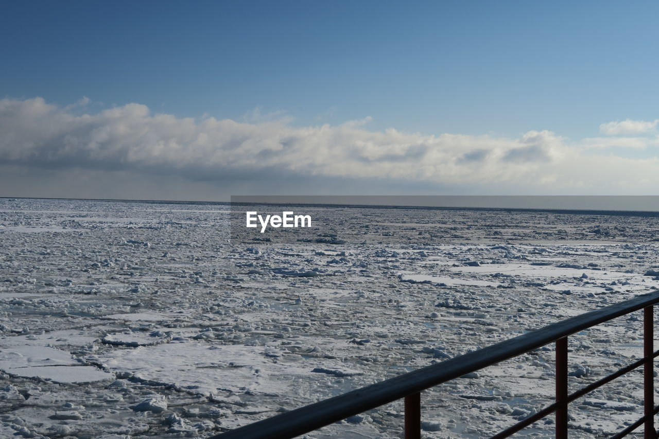 sky, cloud - sky, railing, scenics - nature, beauty in nature, water, sea, nature, horizon, no people, winter, cold temperature, tranquil scene, tranquility, snow, day, horizon over water, outdoors