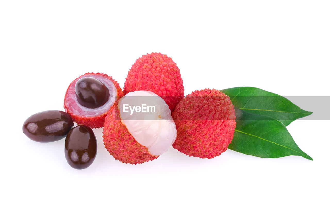 fruit, white background, studio shot, still life, food and drink, freshness, indoors, food, healthy eating, red, close-up, leaf, berry fruit, plant part, no people, copy space, sweet food, cut out, temptation, wellbeing, lychee