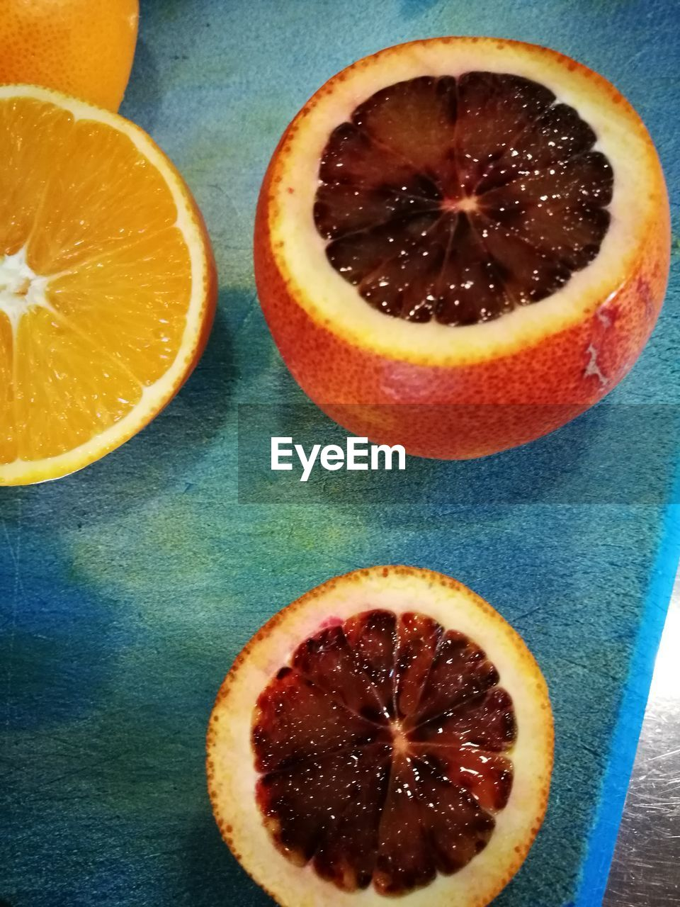 food and drink, orange - fruit, freshness, fruit, citrus fruit, food, indoors, table, slice, cross section, healthy eating, no people, sweet food, close-up, blood orange, day, ready-to-eat