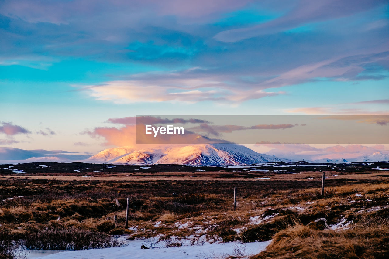 cloud - sky, sky, cold temperature, mountain, snow, beauty in nature, winter, scenics - nature, environment, landscape, nature, non-urban scene, tranquility, tranquil scene, no people, sunset, snowcapped mountain, land, idyllic, power in nature