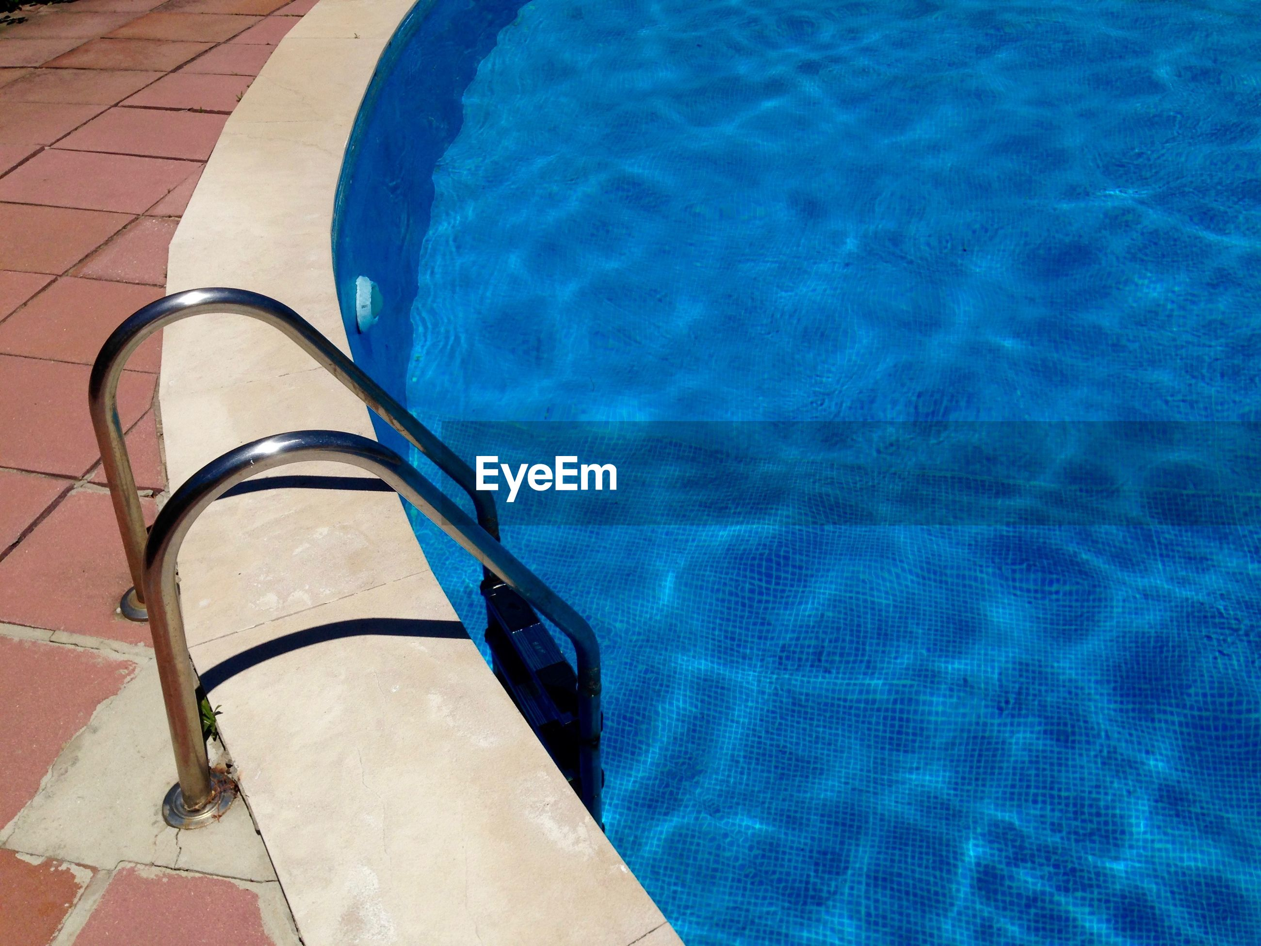 View of ladder in swimming pool