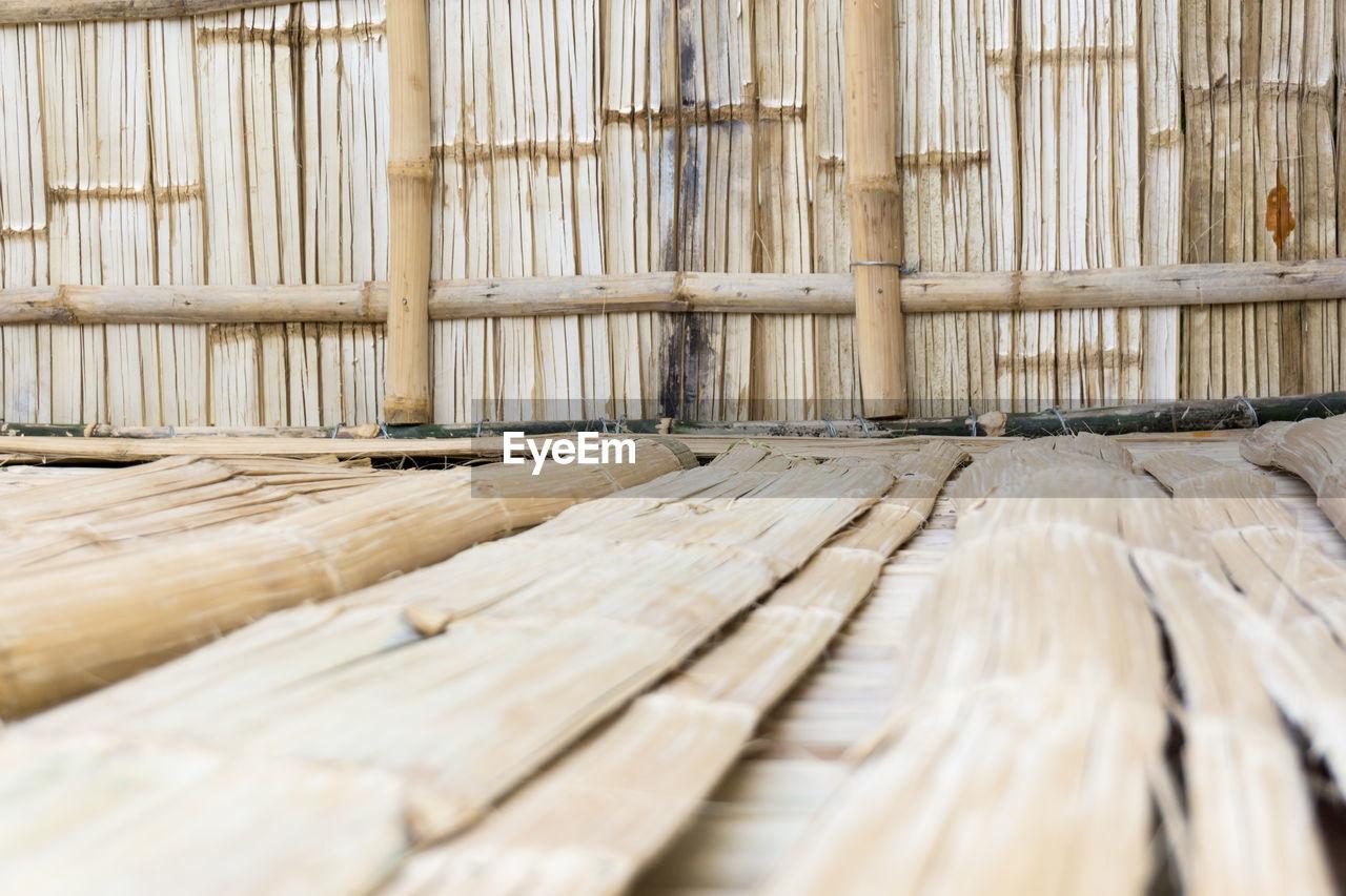 Stack of bamboo on hardwood floor