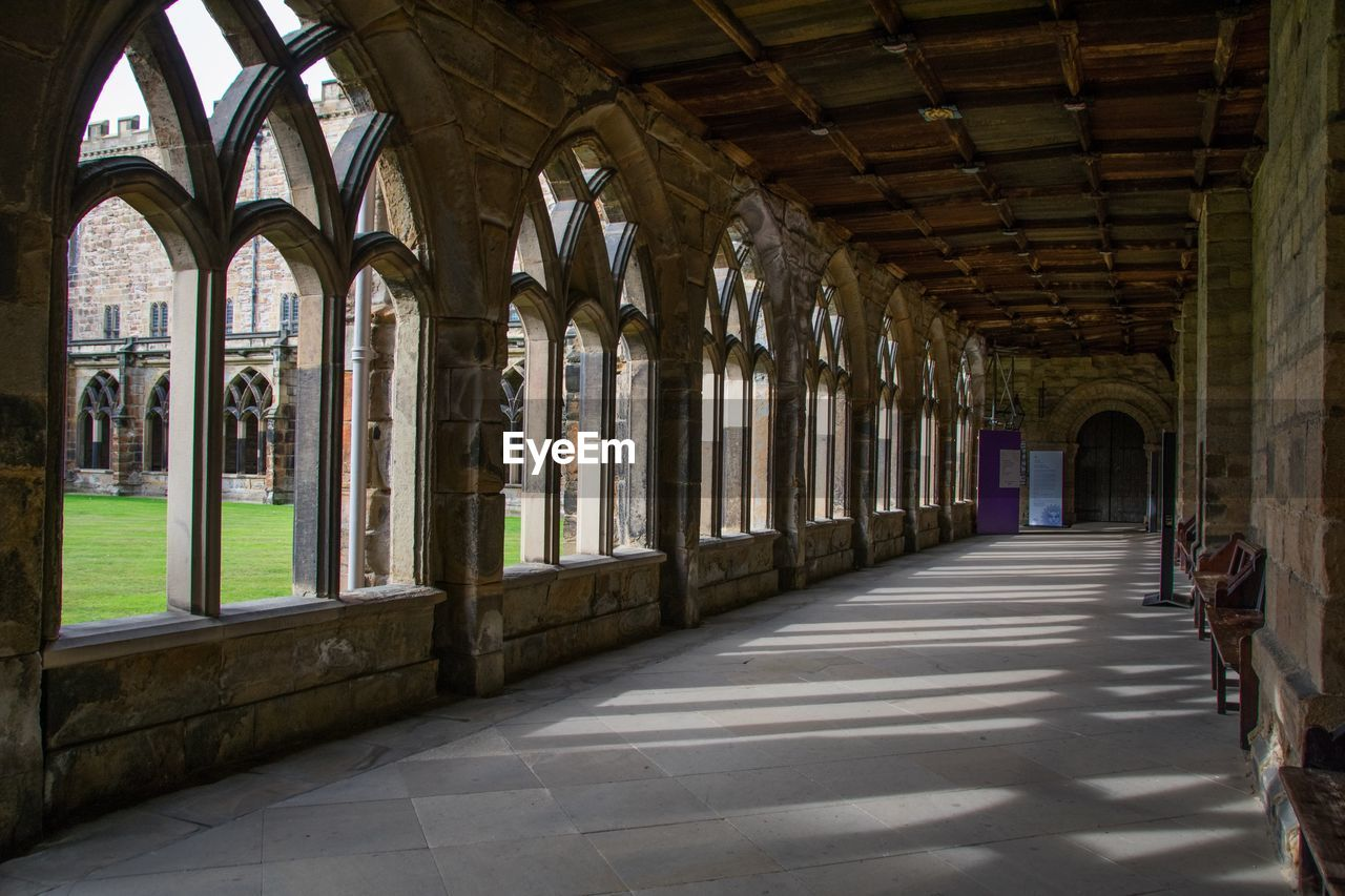 architecture, arch, built structure, building, indoors, arcade, architectural column, day, the past, no people, history, the way forward, corridor, direction, window, old, in a row, ceiling, sunlight, empty, colonnade