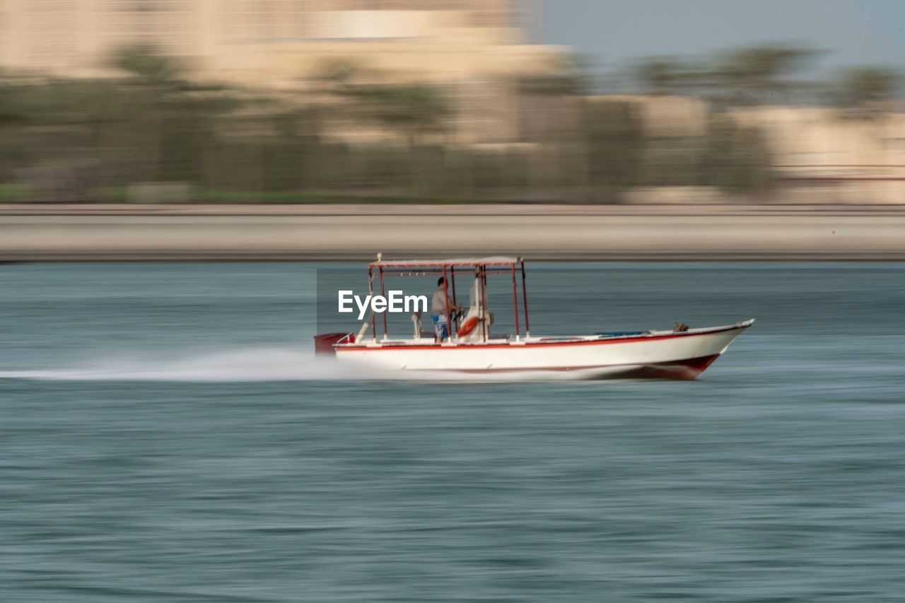 nautical vessel, transportation, water, mode of transportation, waterfront, motion, real people, men, two people, nature, day, adult, sailing, travel, lifestyles, sea, on the move, leisure activity, outdoors