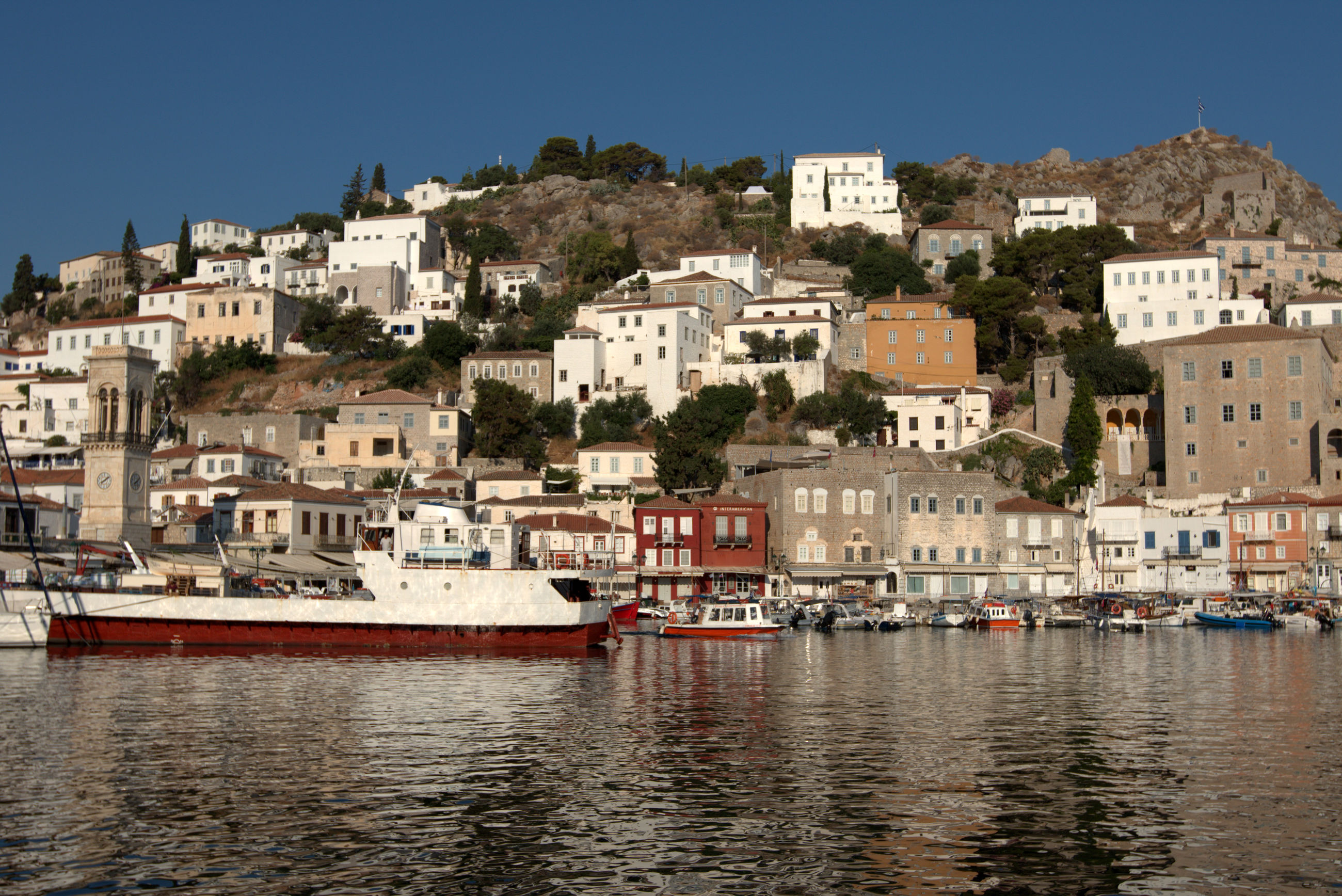 Townscape by sea against clear sky