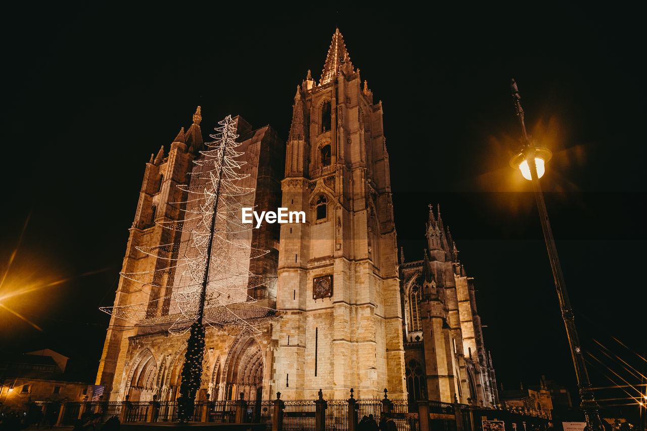 building exterior, architecture, built structure, night, place of worship, religion, low angle view, belief, building, spirituality, sky, travel destinations, illuminated, the past, history, nature, travel, tourism, no people, gothic style, lens flare, spire