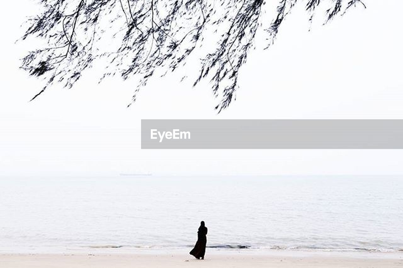 sea, silhouette, beach, water, horizon over water, beauty in nature, nature, one person, tranquil scene, scenics, outdoors, leisure activity, clear sky, day, standing, sky, adult, one man only, people, adults only, only men