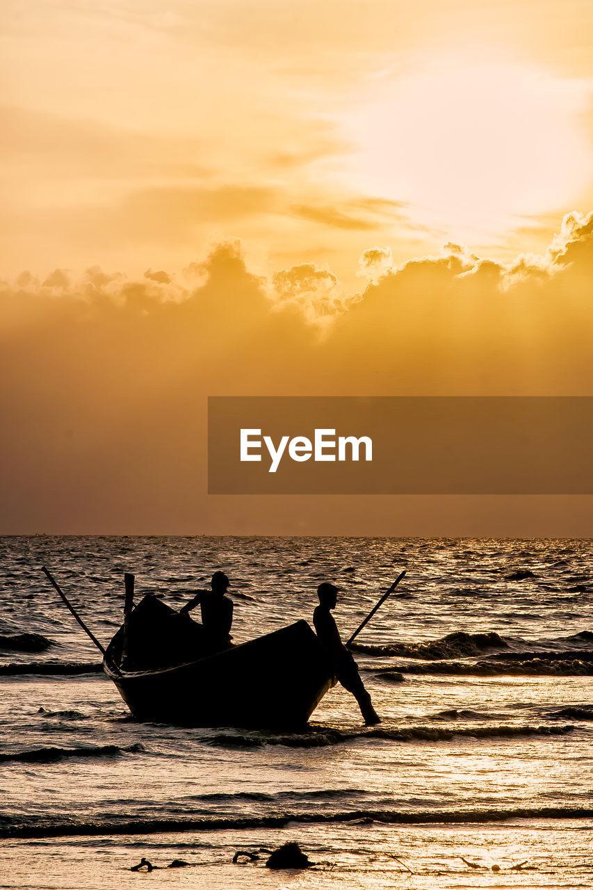 sunset, sky, water, sea, silhouette, orange color, nautical vessel, beauty in nature, transportation, horizon over water, mode of transportation, scenics - nature, men, real people, horizon, waterfront, cloud - sky, nature, idyllic, outdoors, sun