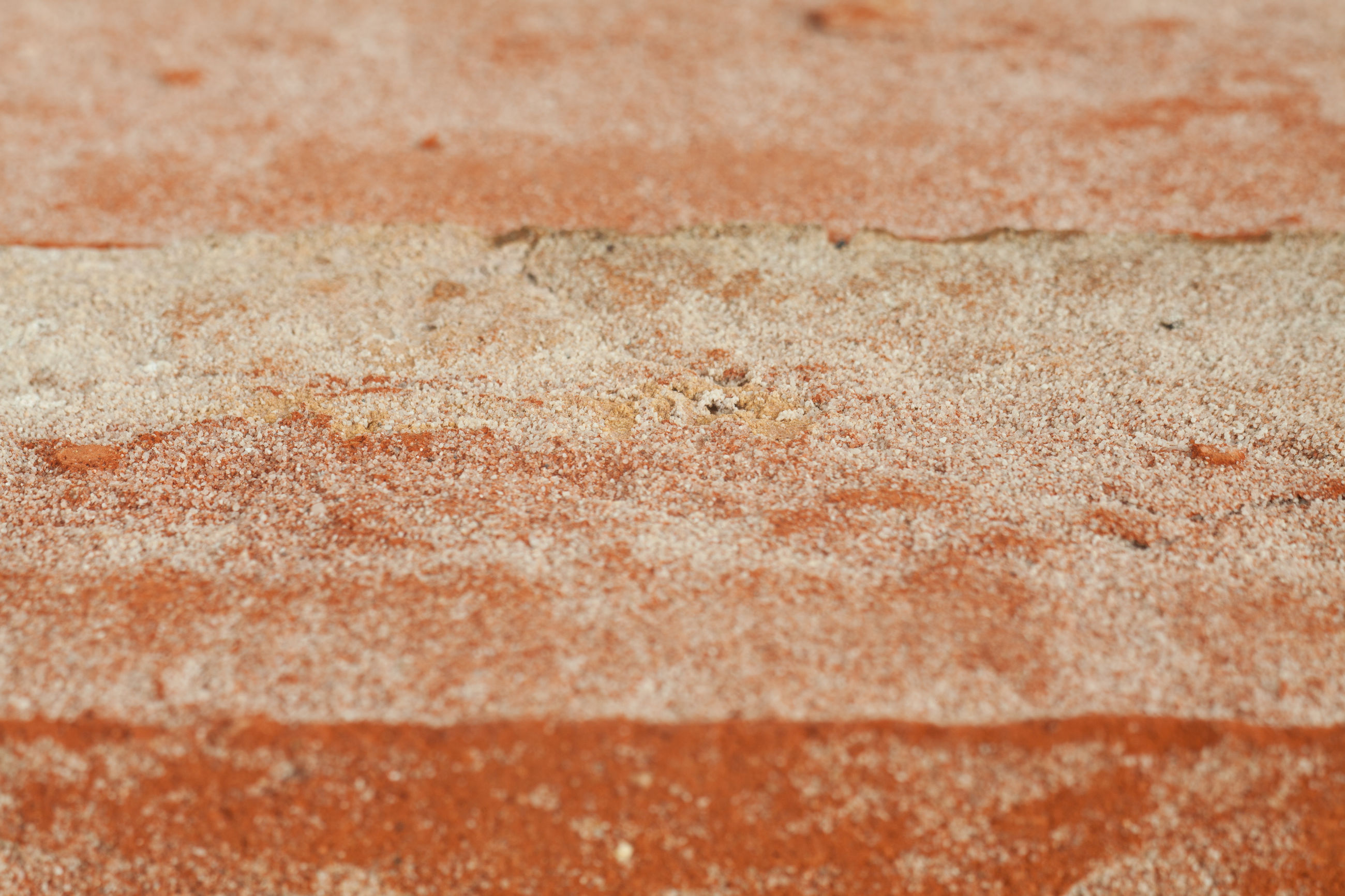 full frame, backgrounds, textured, no people, close-up, pattern, wall - building feature, day, brown, marble, land, sand, built structure, rough, flooring, selective focus, outdoors, nature, marbled effect, red, surface level, concrete, abstract backgrounds