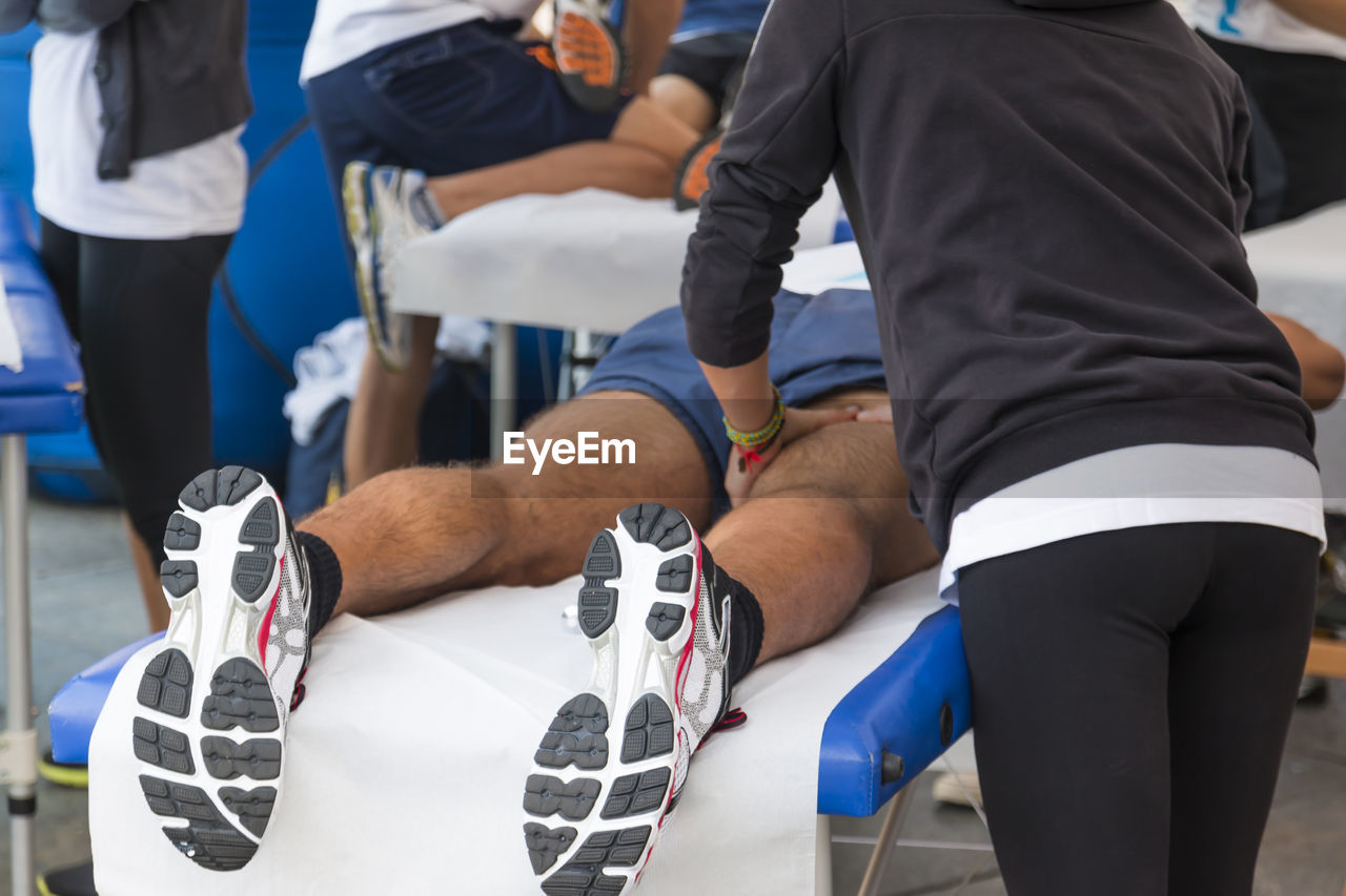 Trainers Giving Massage To Athletes