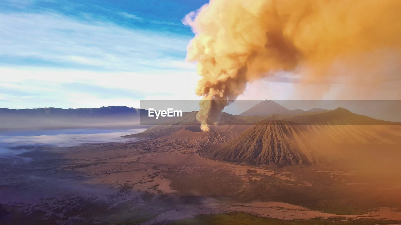 Smoke Erupting From Mt Bromo Against Cloudy Sky