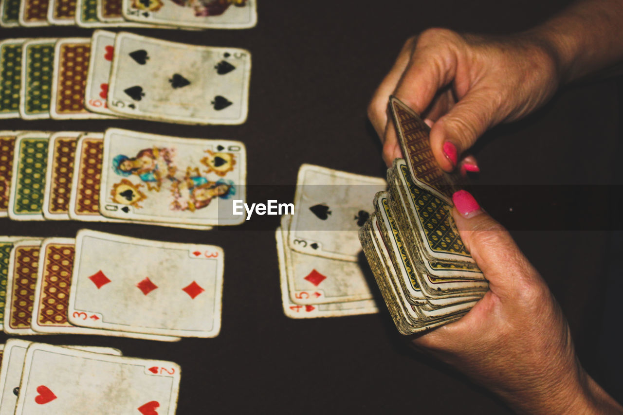 Close-Up Of Woman Playing Cards