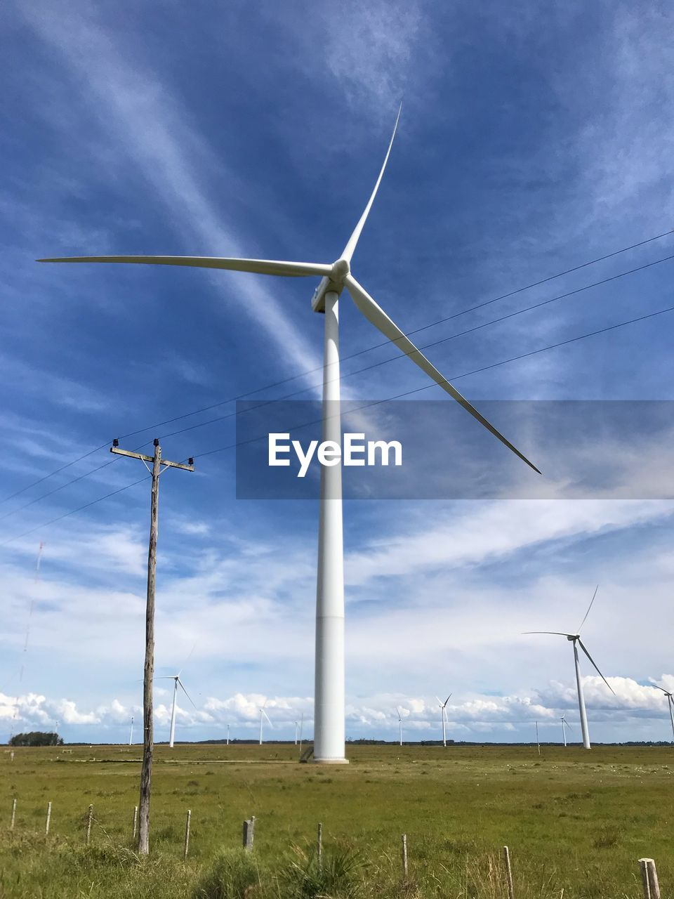 fuel and power generation, renewable energy, environmental conservation, alternative energy, environment, wind turbine, turbine, wind power, sky, field, land, landscape, cloud - sky, nature, technology, rural scene, day, no people, grass, beauty in nature, outdoors, sustainable resources, power supply