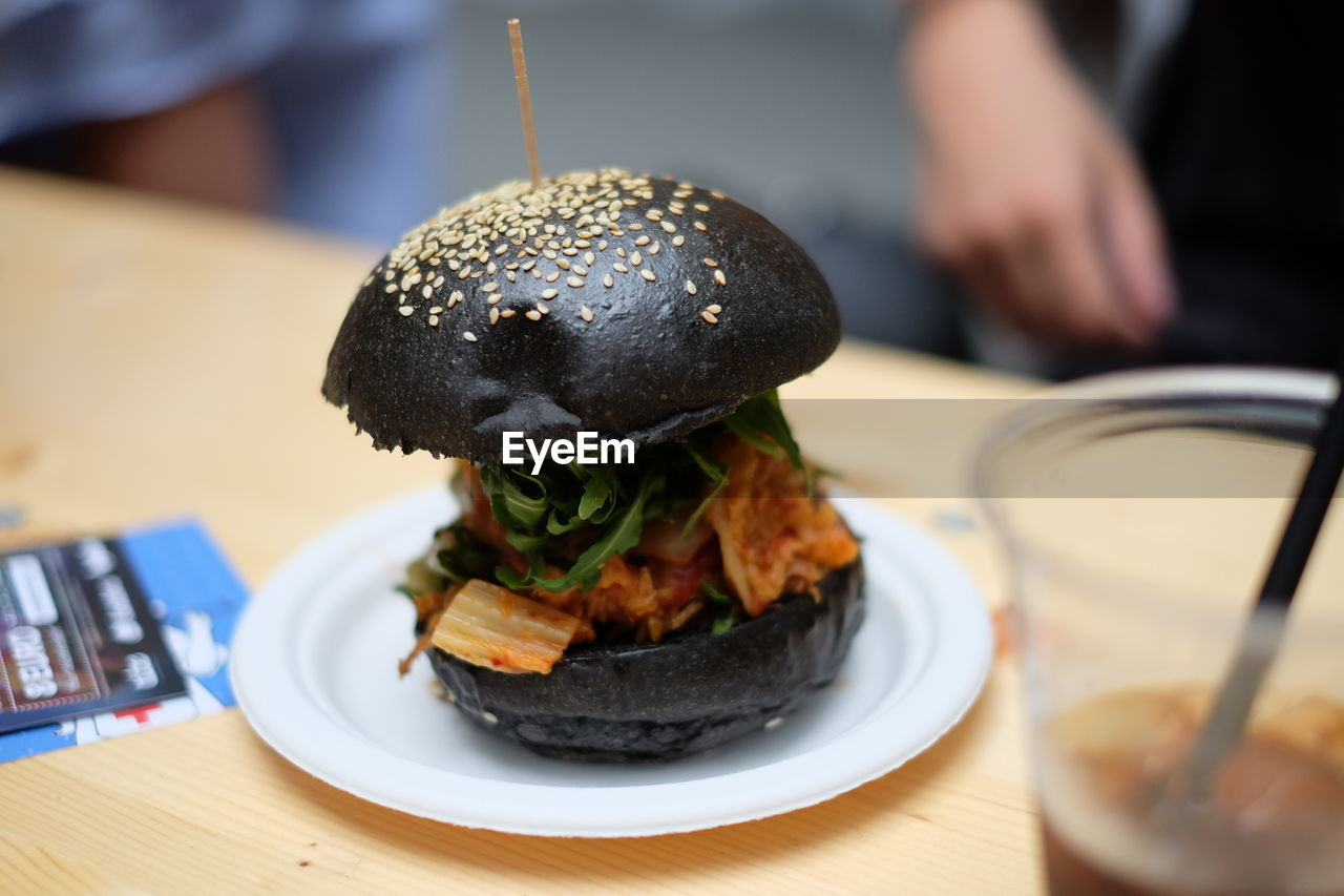Burger Served In Plate On Table At Restaurant