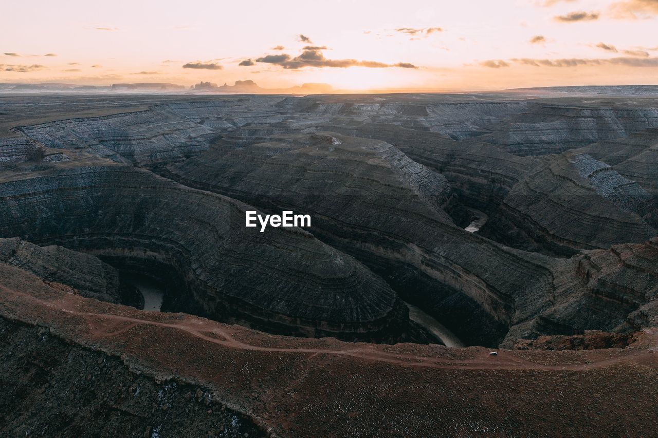 Aerial view of canyon landscape during sunset