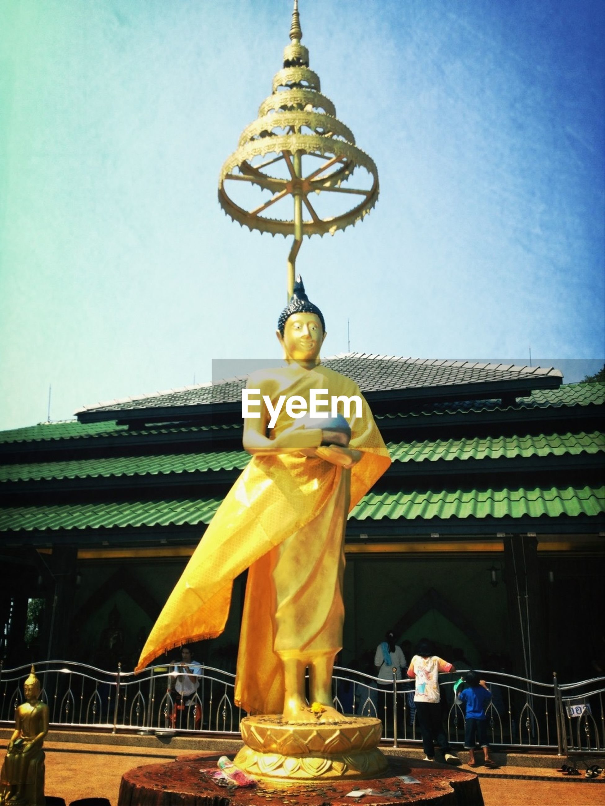 statue, human representation, sculpture, art and craft, art, creativity, religion, spirituality, place of worship, famous place, low angle view, travel destinations, temple - building, buddha, architecture, built structure, travel