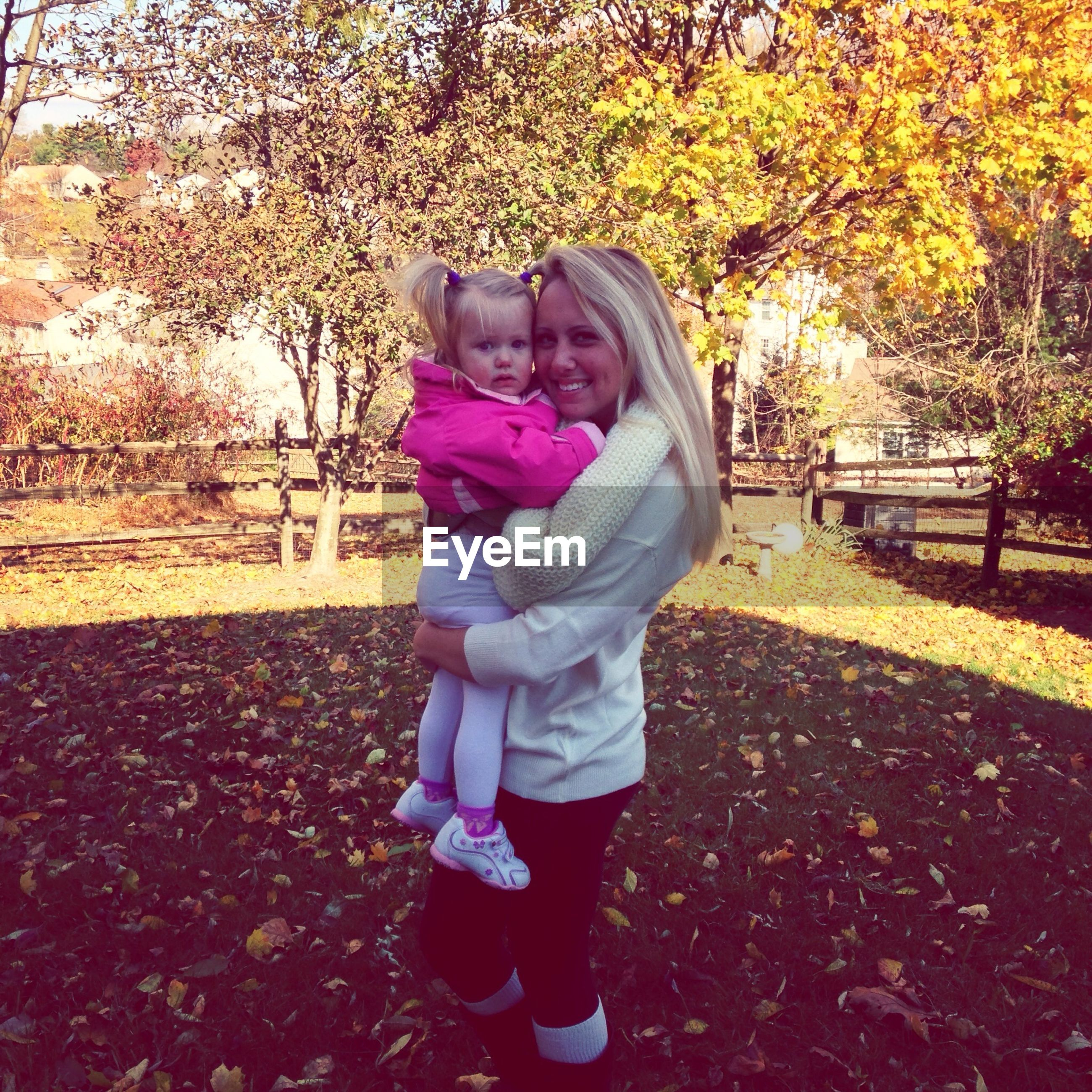 lifestyles, childhood, full length, casual clothing, leisure activity, elementary age, park - man made space, girls, autumn, standing, season, street, rear view, tree, innocence, boys, person, outdoors