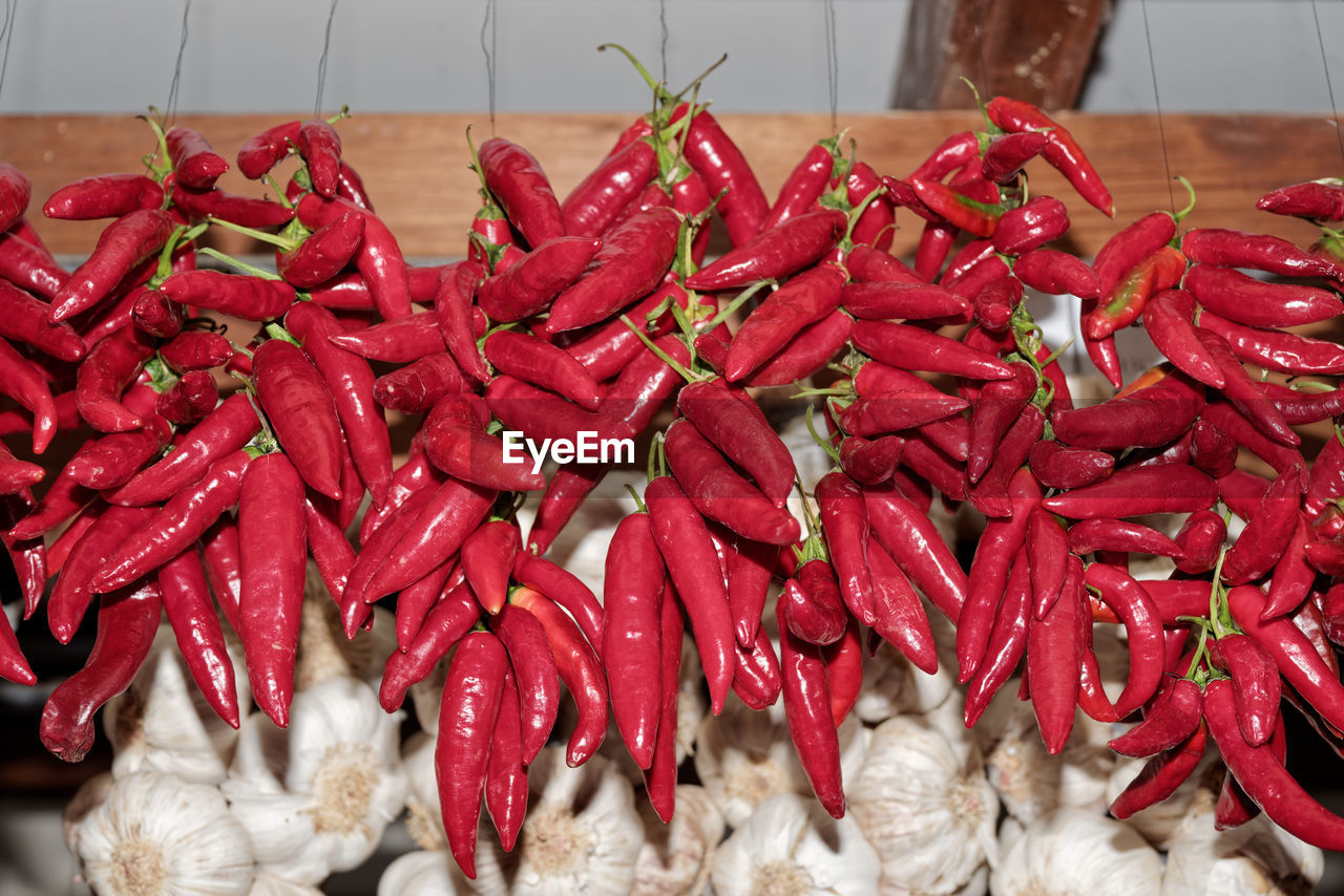 red, food and drink, food, chili pepper, pepper, spice, red chili pepper, freshness, large group of objects, abundance, retail, still life, close-up, no people, vegetable, indoors, high angle view, wellbeing, for sale, healthy eating