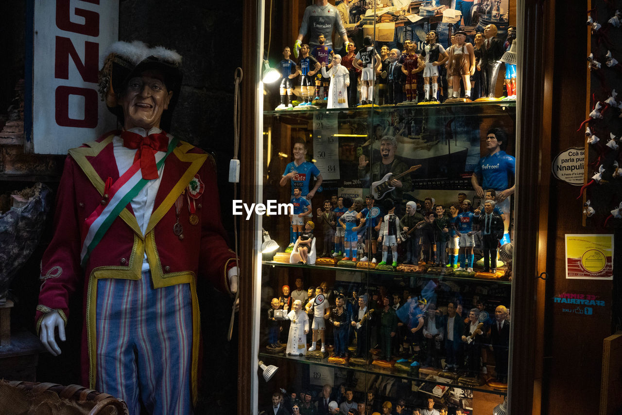 store, retail, shopping, human representation, choice, real people, retail display, representation, standing, variation, male likeness, night, people, men, front view, for sale, business, indoors, adult, buying, consumerism
