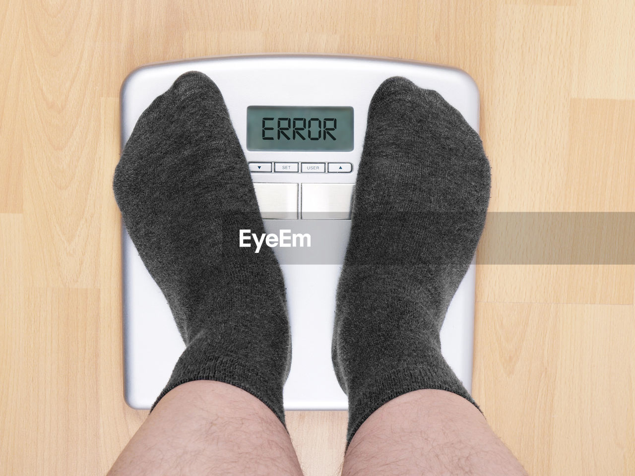 Low Section Of Person Standing On Weight Scale