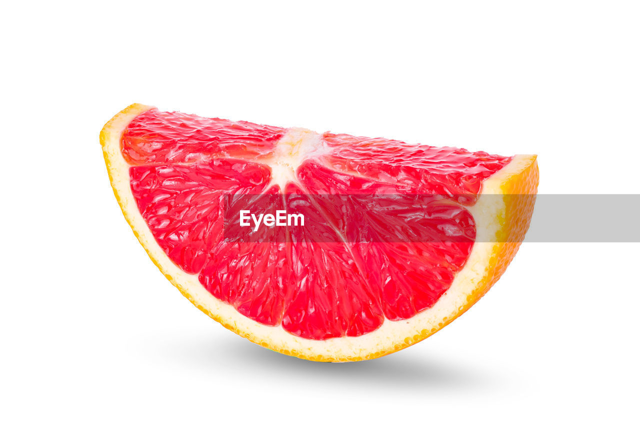 food and drink, food, fruit, studio shot, healthy eating, white background, slice, wellbeing, freshness, citrus fruit, indoors, still life, close-up, cross section, red, cut out, no people, single object, juicy, grapefruit, ripe, orange, antioxidant, chopped
