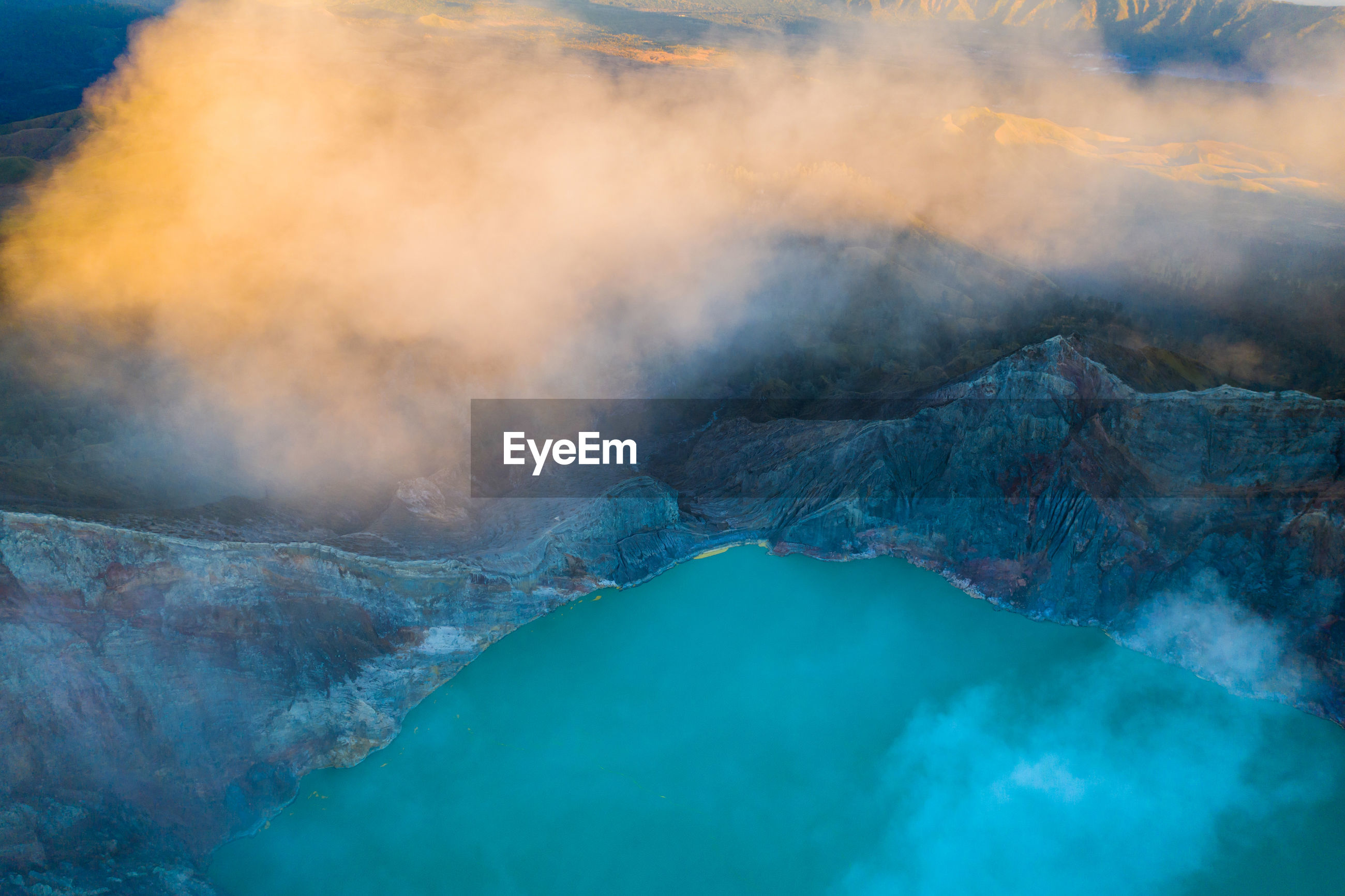 High angle view of hot spring amidst mountains