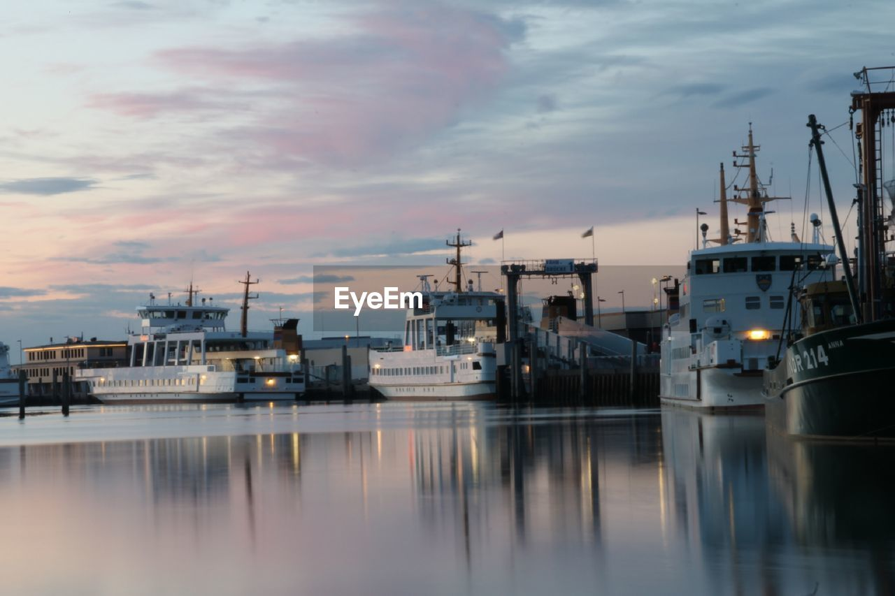 nautical vessel, sky, transportation, water, cloud - sky, moored, mode of transportation, harbor, sunset, waterfront, sea, no people, reflection, nature, pier, industry, outdoors, architecture, commercial dock, yacht, sailboat, fishing industry, marina
