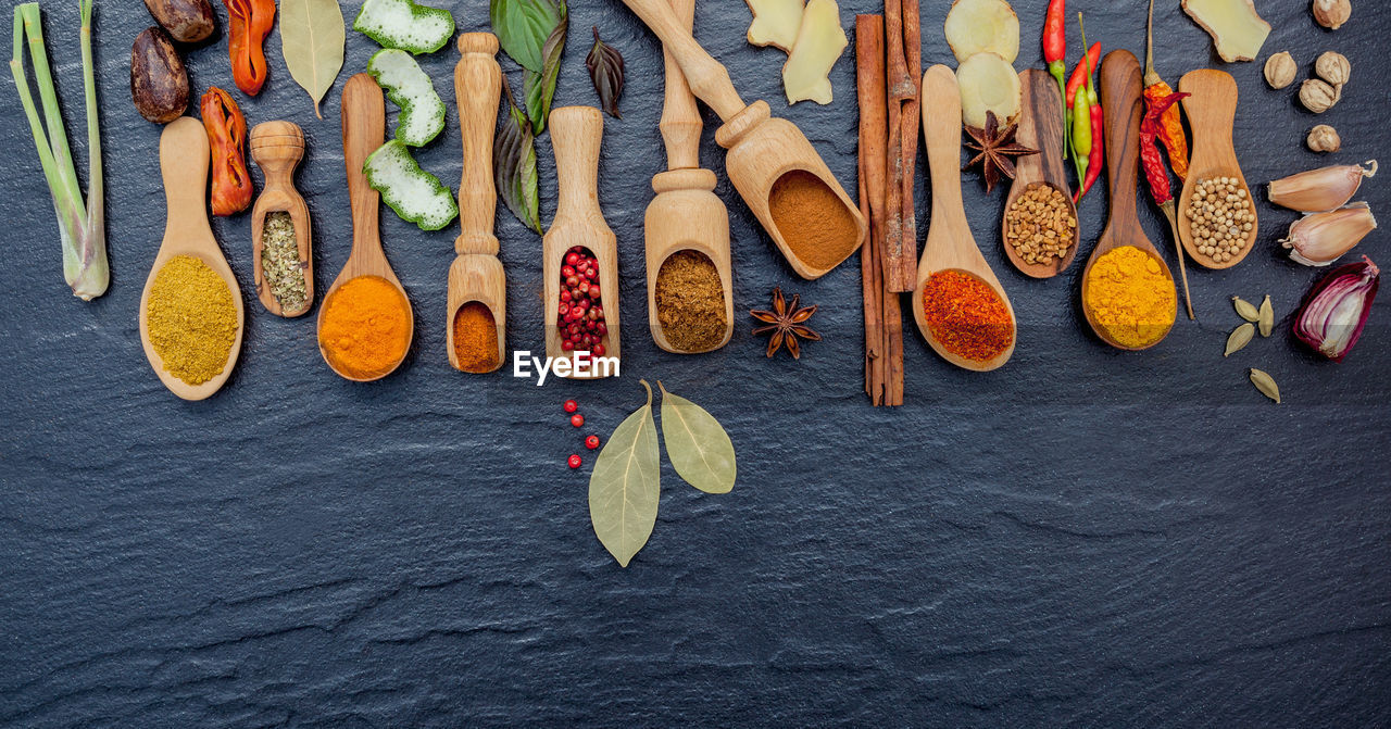High angle view of various spices on marble