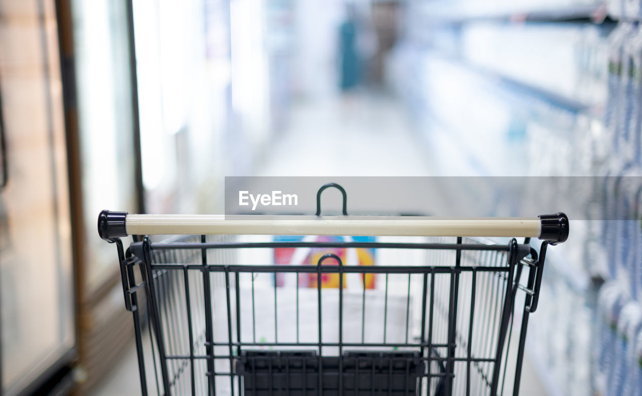 Close-up of empty trolley in store