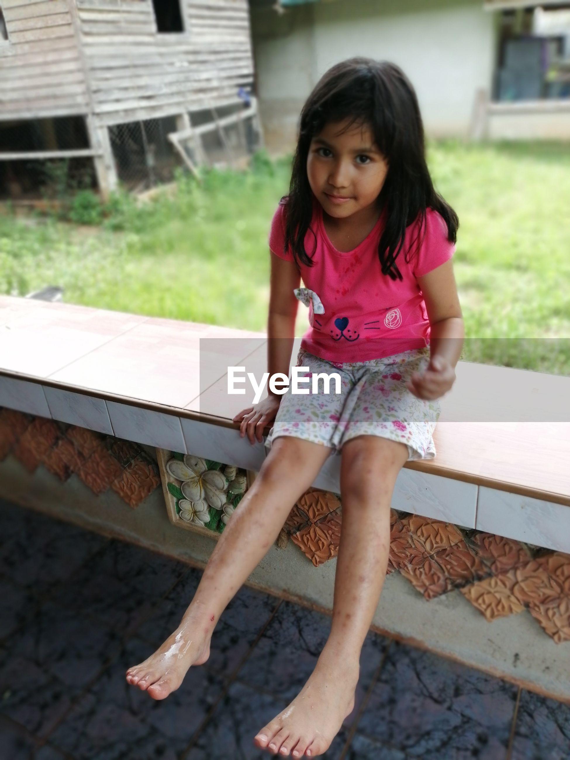 Full length portrait of girl sitting