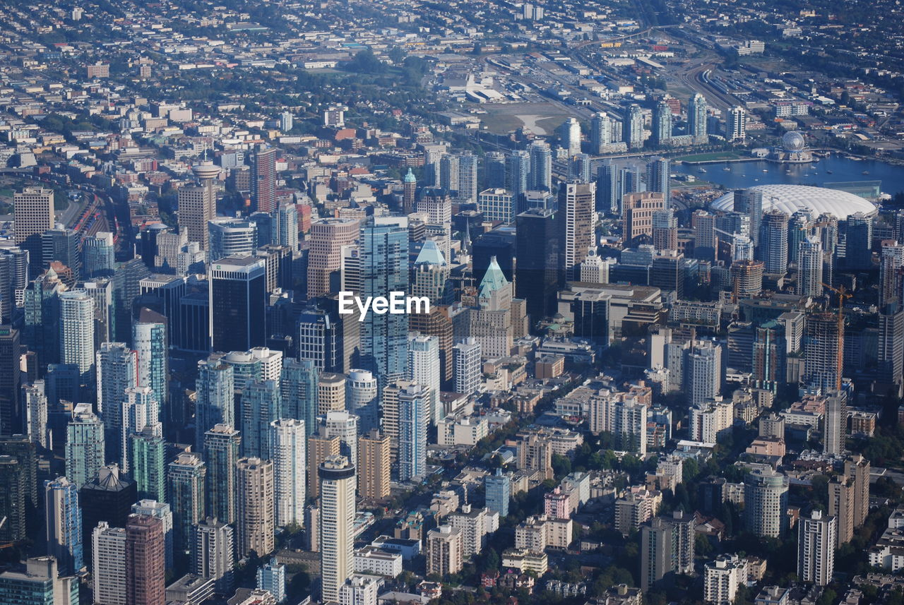 cityscape, building, building exterior, city, office building exterior, architecture, crowd, built structure, skyscraper, residential district, crowded, modern, aerial view, tall - high, tower, high angle view, downtown district, landscape, urban skyline, outdoors, financial district, apartment, urban sprawl