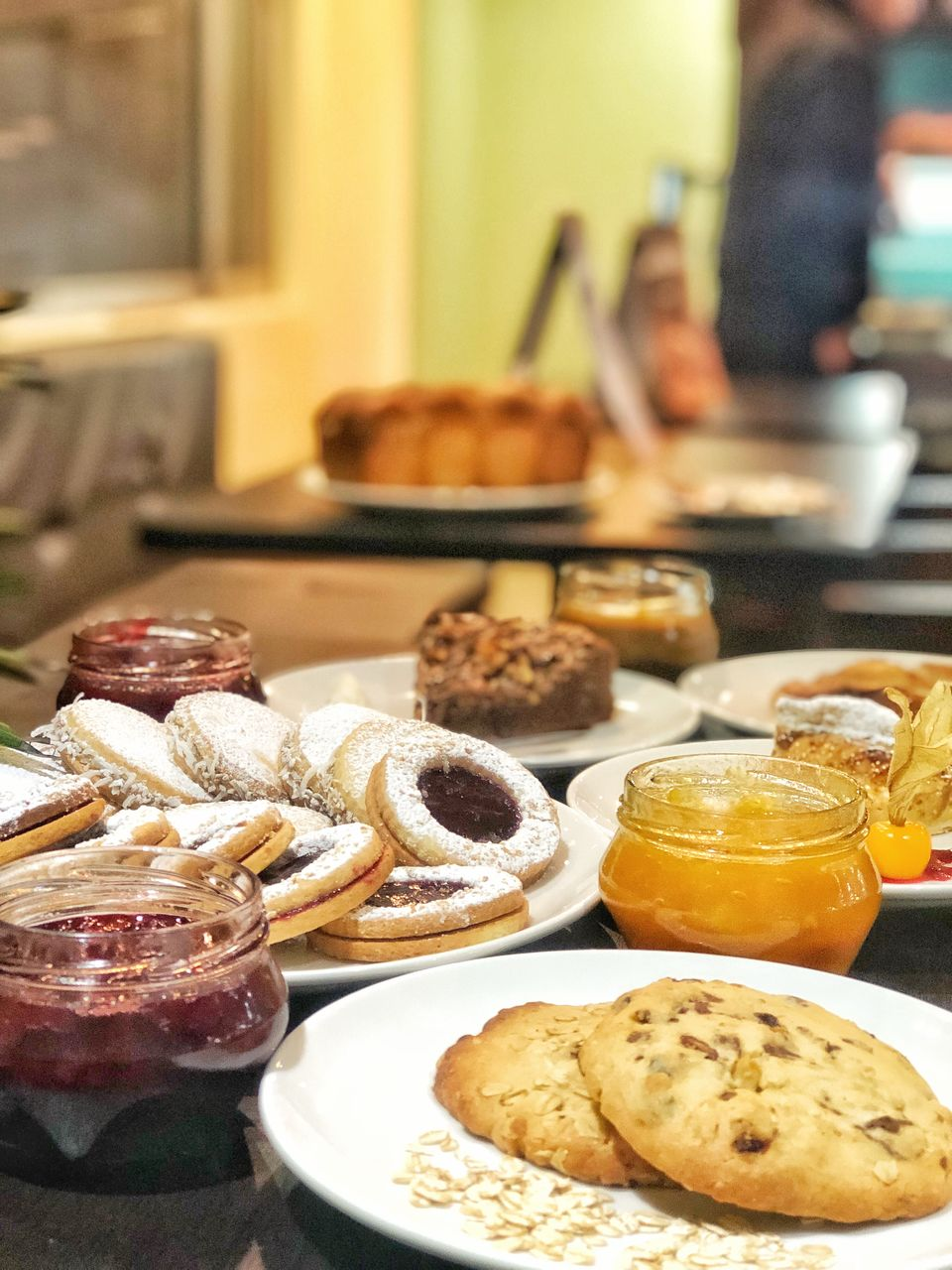 food and drink, food, freshness, table, indoors, ready-to-eat, still life, plate, focus on foreground, baked, sweet food, serving size, dessert, cake, choice, indulgence, sweet, unhealthy eating, temptation, variation, glass, snack, muffin
