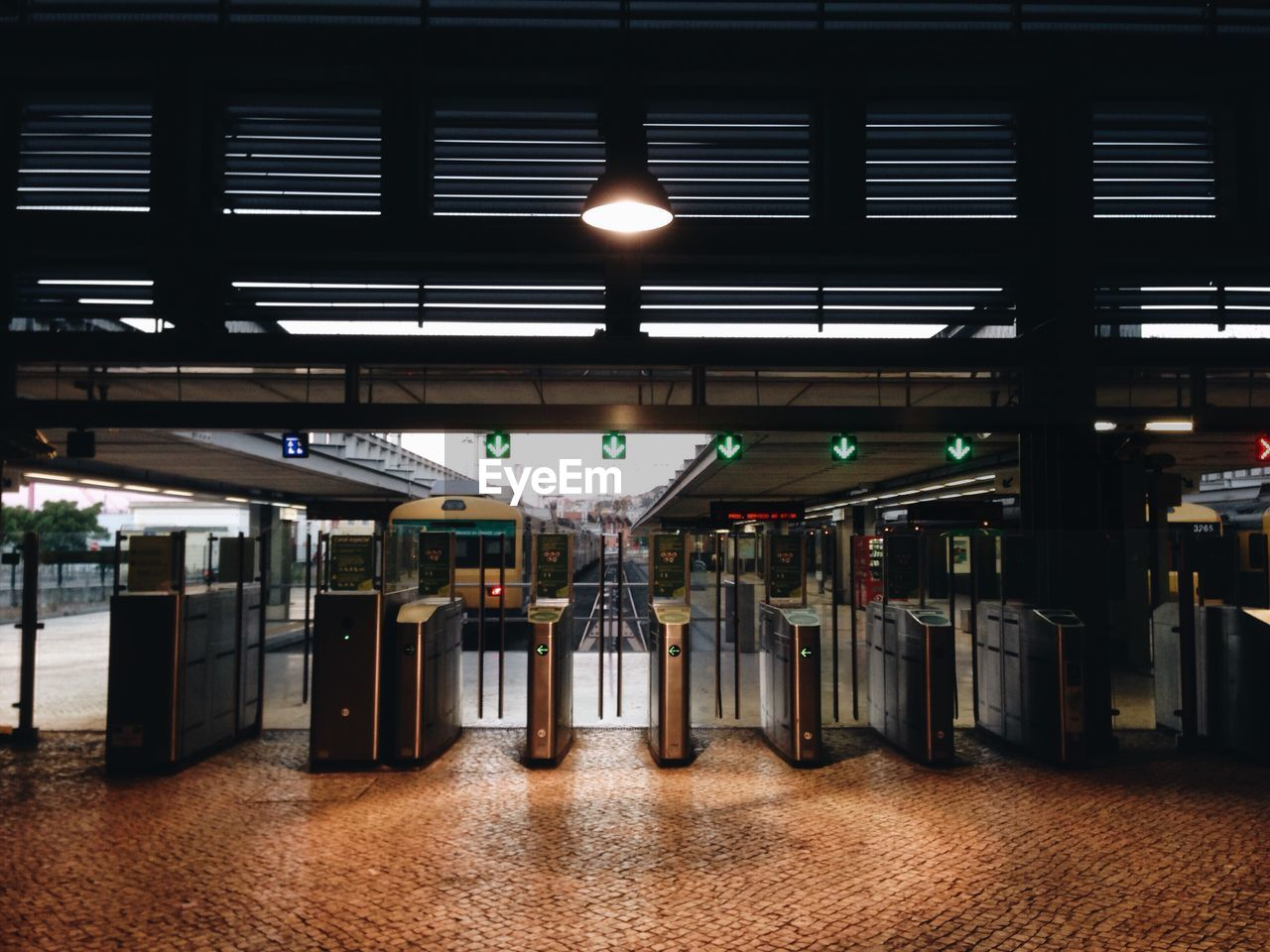 illuminated, ceiling, lighting equipment, indoors, in a row, railroad station platform, railroad station, transportation, rail transportation, train - vehicle, public transportation, no people, architecture