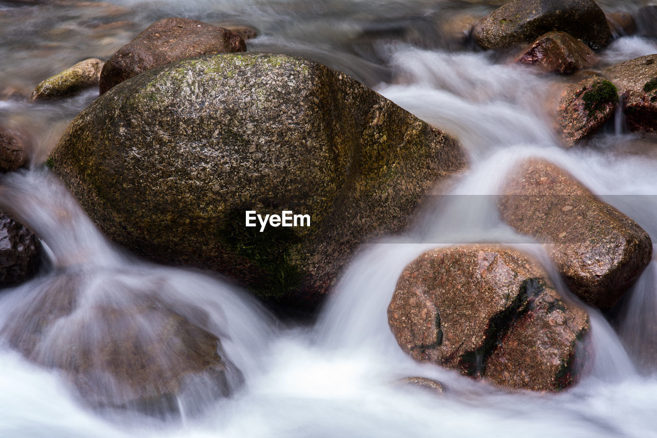 motion, long exposure, rock, rock - object, solid, blurred motion, water, no people, beauty in nature, sea, land, nature, flowing water, scenics - nature, waterfall, day, outdoors, aquatic sport, flowing, stream - flowing water, purity