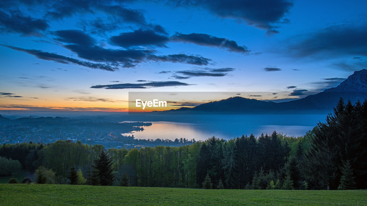 sky, beauty in nature, cloud - sky, scenics - nature, tranquil scene, tranquility, plant, tree, sunset, water, nature, non-urban scene, mountain, no people, idyllic, environment, land, landscape, lake, outdoors
