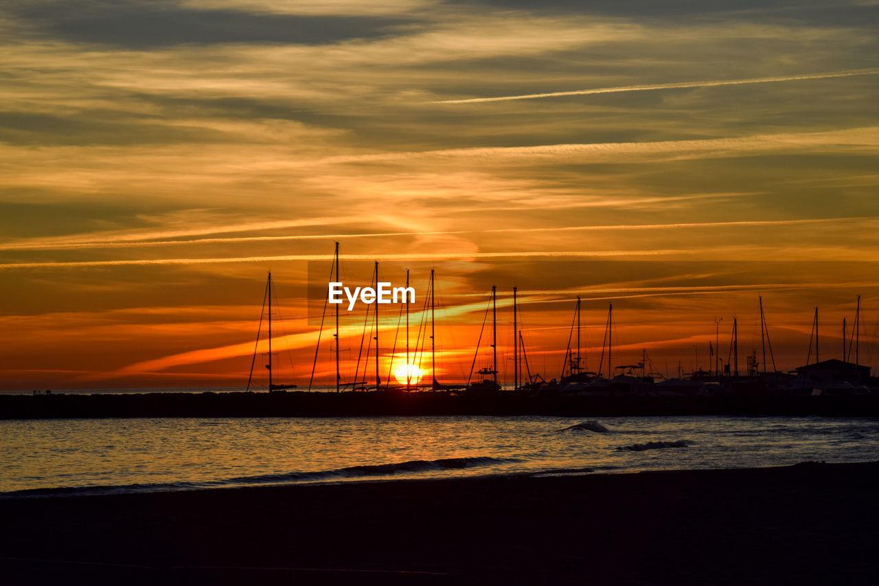sunset, sky, nautical vessel, sea, orange color, water, cloud - sky, beauty in nature, no people, nature, transportation, scenics, mode of transport, outdoors, mast
