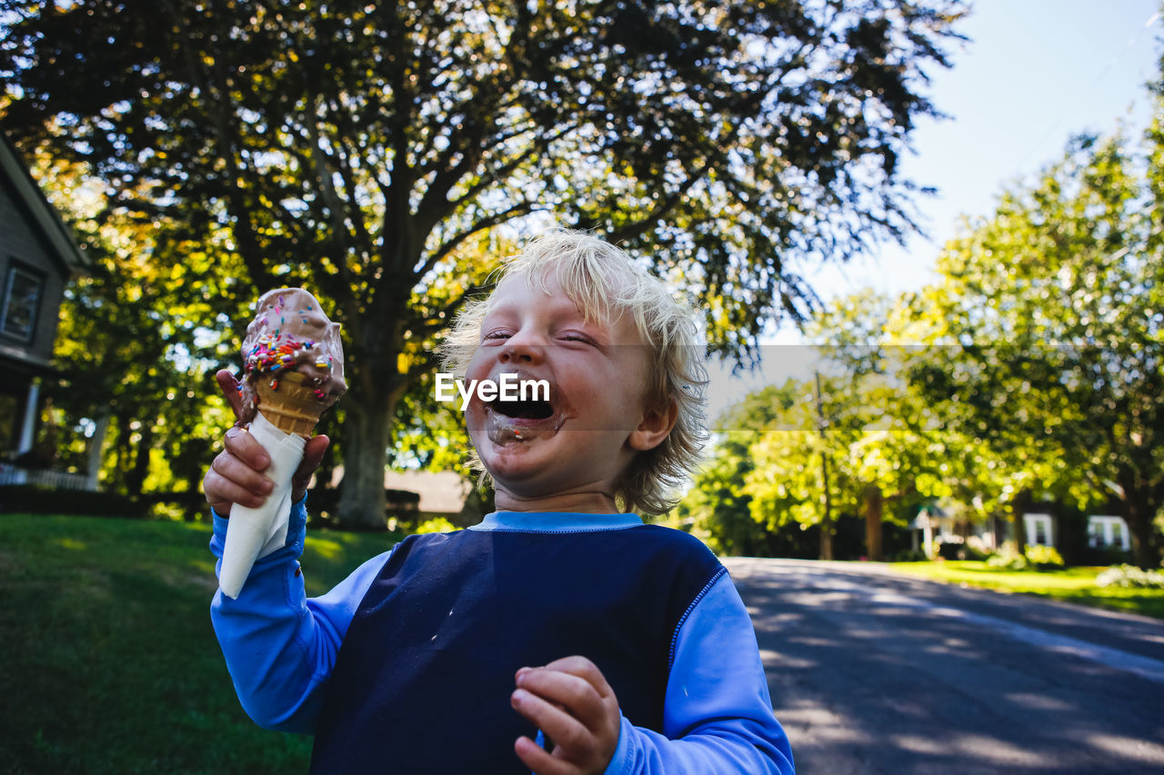 Close-Up Of Boy Holding Ice Cream