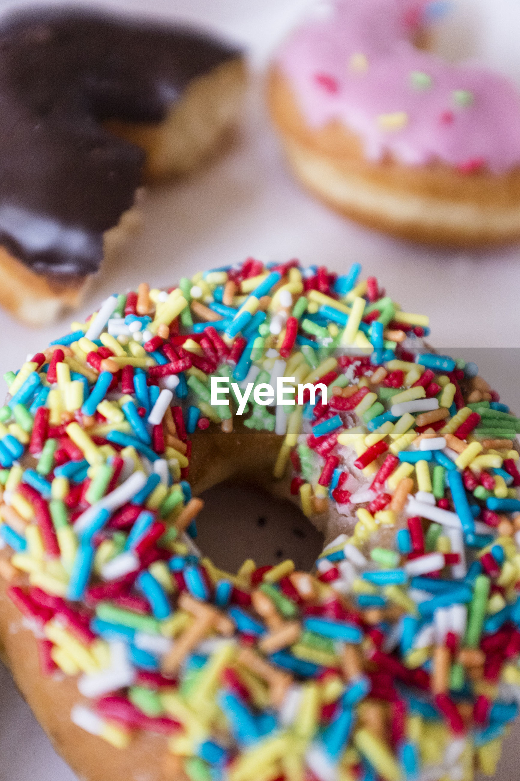 Baked doughnut with colored sprinkles