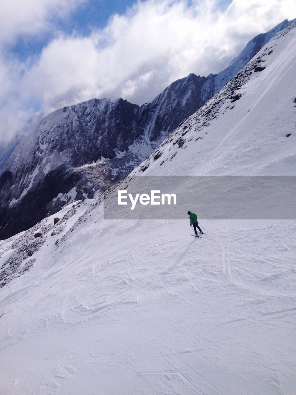 High Angle View Of Man Skiing On Snowcapped Mountain
