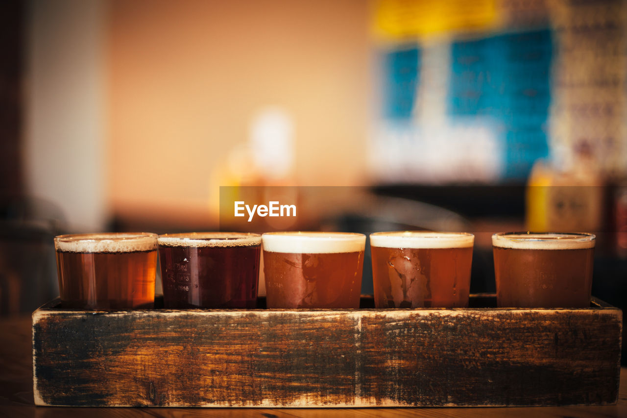 Close-Up Of Beer Served In Wooden Tray At Bar