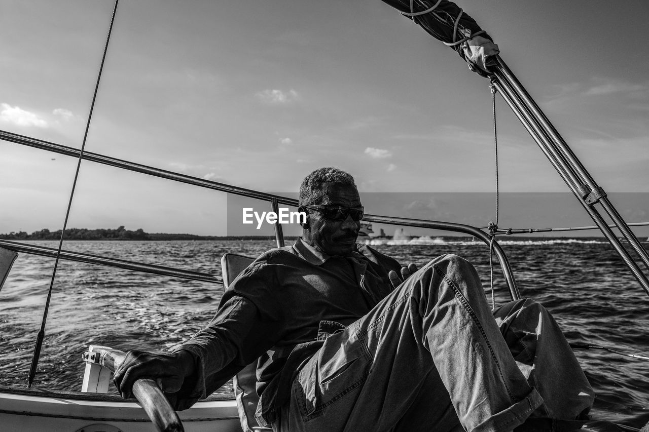 sea, one person, water, real people, outdoors, sky, day, leisure activity, nautical vessel, smiling, nature, horizon over water, people