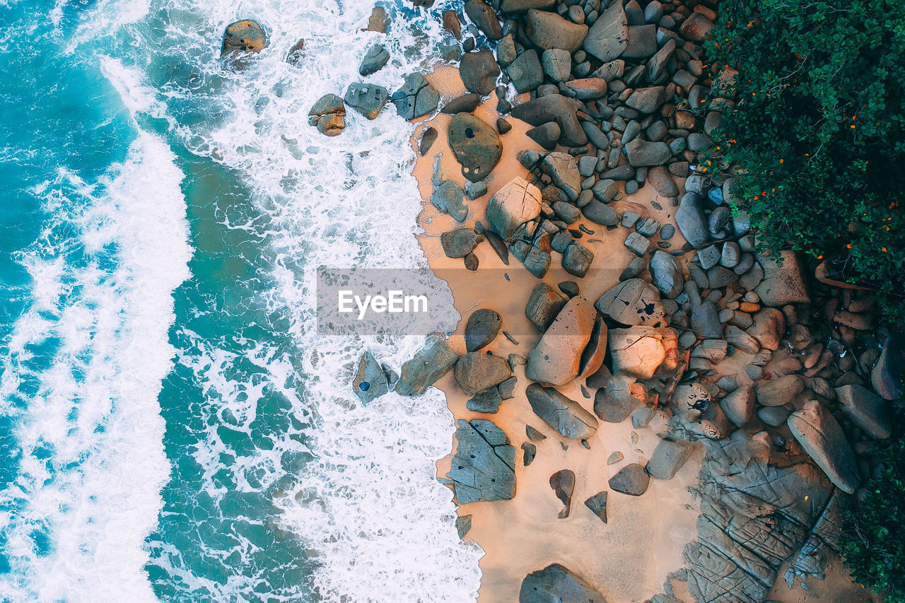 water, nature, no people, motion, day, sea, solid, high angle view, representation, outdoors, beauty in nature, rock, human representation, aquatic sport, art and craft, sunlight, rock - object, swimming pool, flowing water