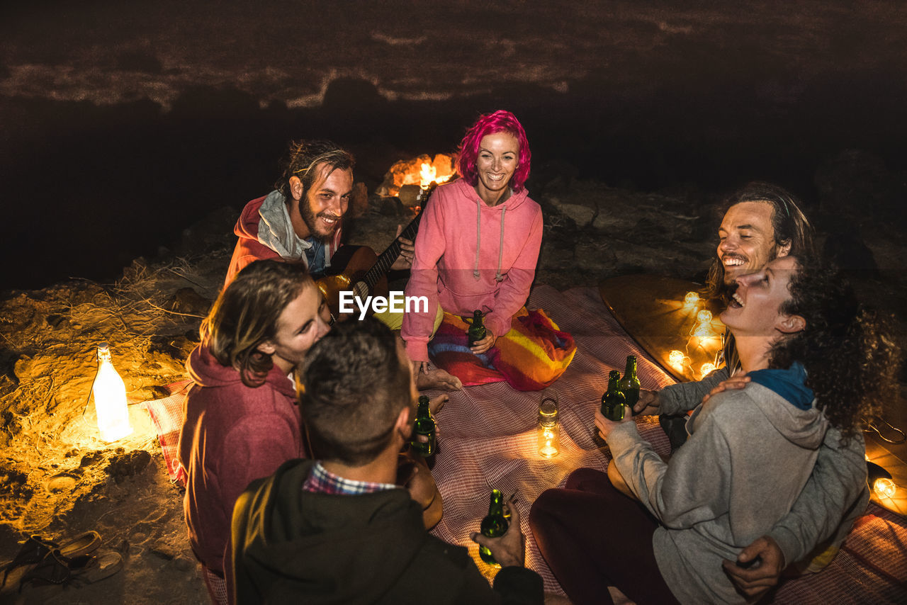 Group of people camping at night