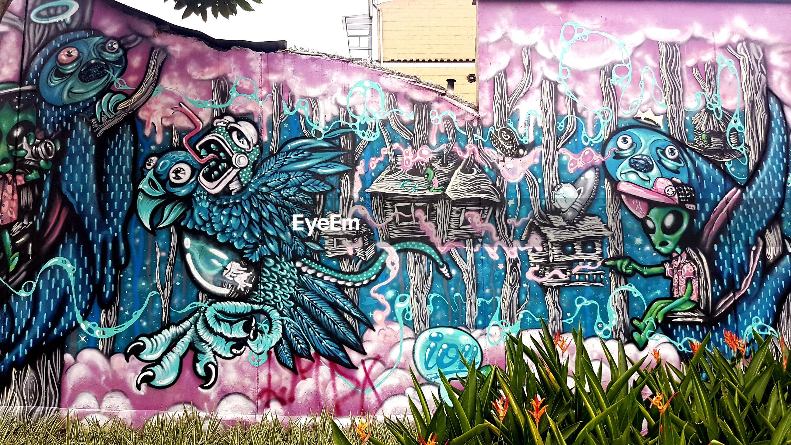 art and craft, multi colored, creativity, representation, no people, close-up, graffiti, day, pattern, craft, architecture, outdoors, plant, wall, human representation, paint, street art, built structure, mural, ornate, festival, floral pattern, turquoise colored