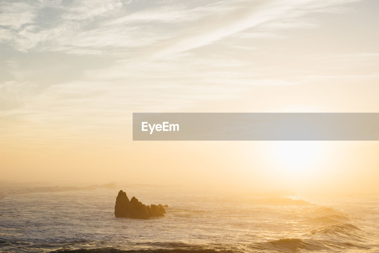 water, sea, sky, scenics - nature, sunset, beauty in nature, waterfront, cloud - sky, tranquil scene, tranquility, rock, horizon over water, nature, horizon, idyllic, rock - object, non-urban scene, no people, solid, outdoors, stack rock